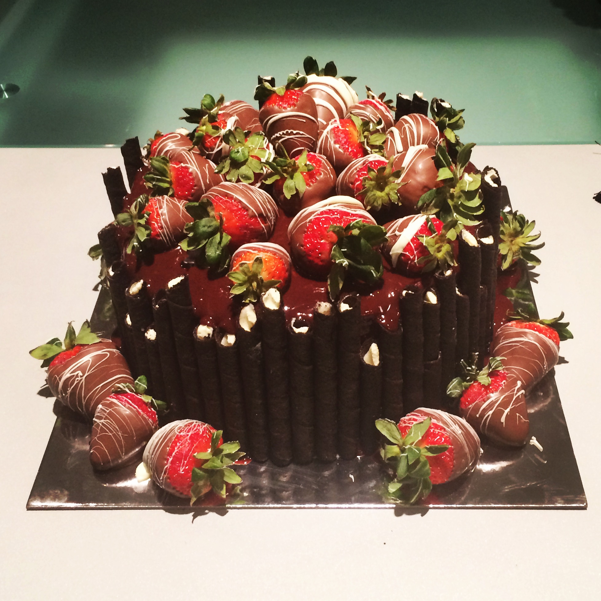 Chocolate Cake topped with Chocolate Covered Strawberries ...